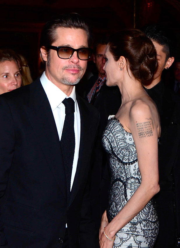 Angelina Jolie and Brad Pitt arrive at the world premiere of Unbroken at the State Theatre on November 17, 2014 in Sydney, Australia.