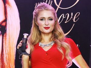 Paris Hilton turns heads in figure-hugging red dress while promoting 17th fragrance