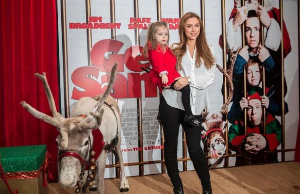 Una Foden attends the Get Santa premiere with daughter Aoife, 30 November 2014