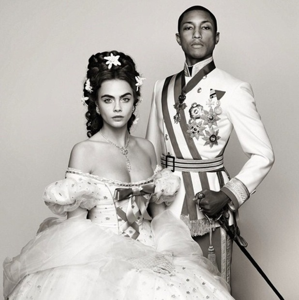 Cara Delevingne and Pharrell Williams pose while filming a short film for Chanel - 26 November 2014