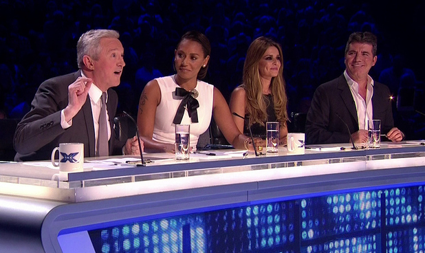X Factor judges - Louis, Mel, Cheryl and Simon - on the judging panel. 11 October 2014.