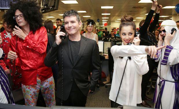 Simon Cowell and Cheryl Fernandez-Versini ICAP's Charity Day, London 3 December