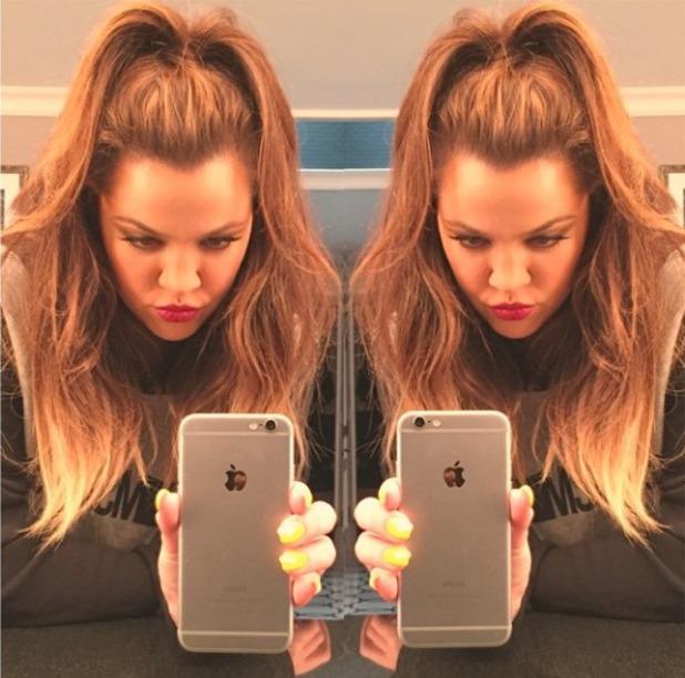 Khloe Kardashian shows off her fluoro yellow nails while taking selfie, 1 December 2014