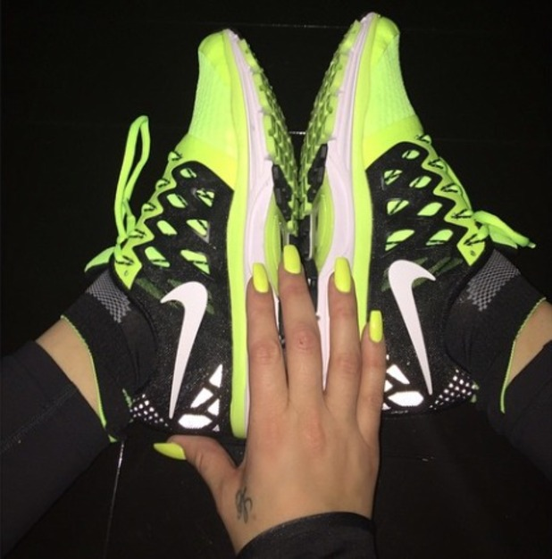 Khloe Kardashian shows off her fluoro yellow nails and matching Nike trainers, 2 December 2014