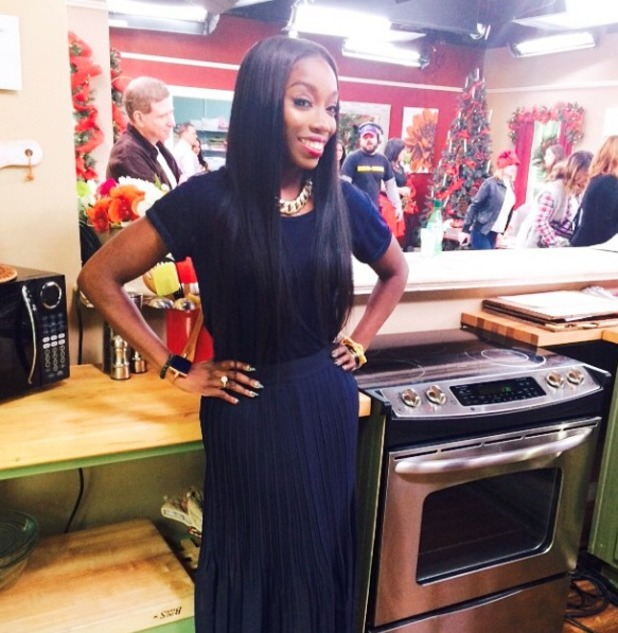 Estelle shows off her green crocodile nails while on Christmas set, 1 December 2014