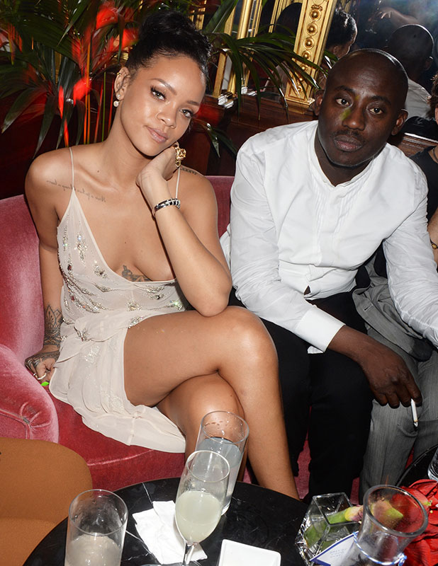 Rihanna and Edward Enninful attend a party in celebration of Edward Enninful in The Oscar Wilde Bar, Hotel Cafe Royal, on December 1, 2014 in London, England.