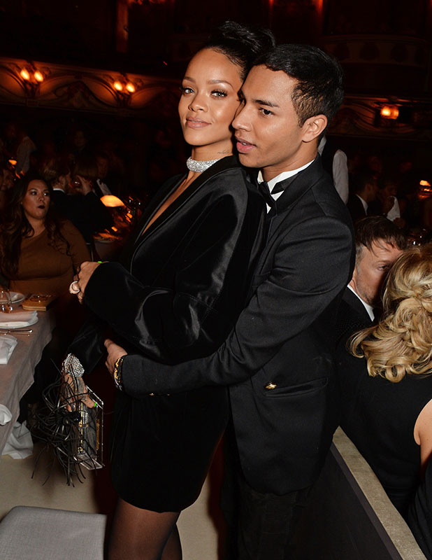 Rihanna and Olivier Rousteing in The Oscar Wilde Bar, Hotel Cafe Royal, on December 1, 2014 in London, England.
