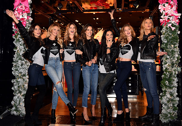 (L-R) Victoria's Secret models Lily Aldridge, Candice Swanepoel, Behati Prinsloo, Alessandra Ambrosio, Adriana Lima, Doutzen Kroes and Karlie Kloss attend the 2014 Victoria's Secret Fashion Show - Bond Street Media Event on December 1, 2014 in London, United Kingdom.