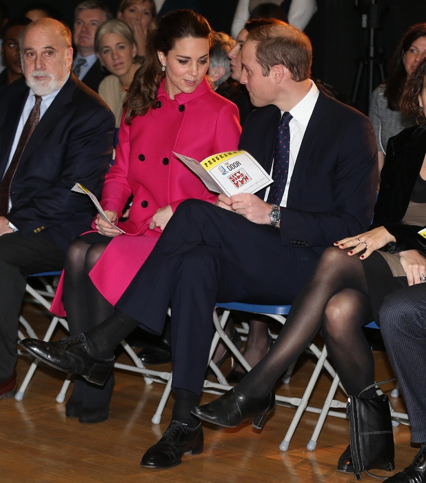 Prince William, Duke of Cambridge and Catherine, Duchess of Cambridge wait for the start of a performance during their visit to The Door on December 9, 2014 in New York City.