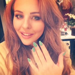 Lydia Bright shows off her green manicure after a pampering session with The Vintage Cosmetic Company, 16 December 2014