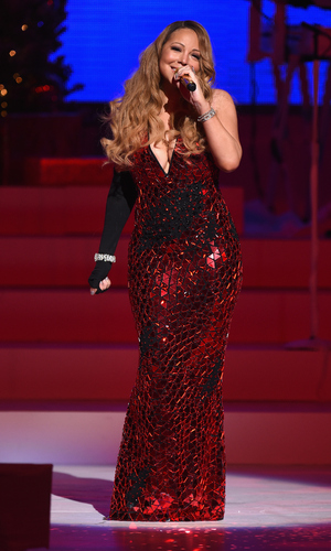 Mariah Carey performs her holiday smash hits at the Beacon Theatre on December 15, 2014 in New York City.