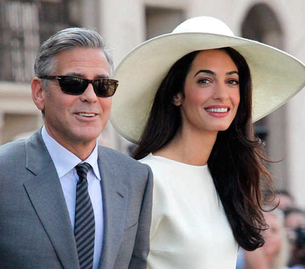 George Clooney and Amal Alamuddin after their marriage civil ceremony in Venice. Former mayor of Rome, Walter Veltroni, also attended, September 2014