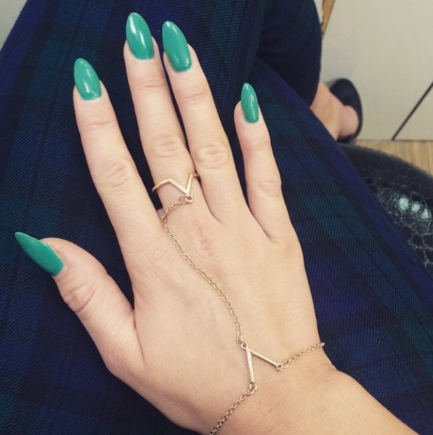 Lydia Bright shows off her green manicure, 19 December 2014