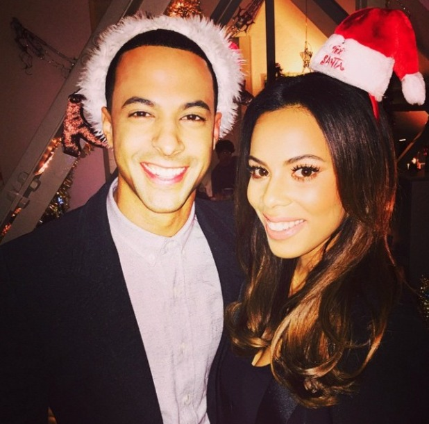 Rochelle and Marvin Humes pose in their Santa hats for #TextSanta,12 December 2014