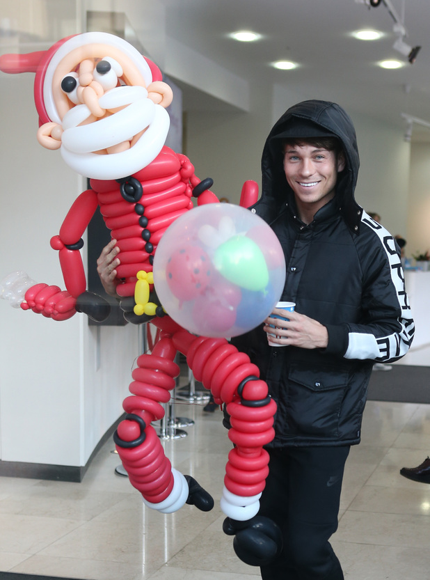 Joey Essex at the ITV studios holding a Santa Claus made using balloons - 8/12/2014.