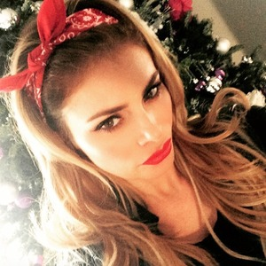 Chloe Sims shows off her festive red lips and headscarf, 28 December 2014