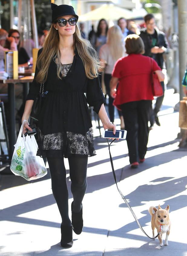 Paris Hilton and Peter Pan walk through Los Angeles after stopping at Subway - 5 January 2015