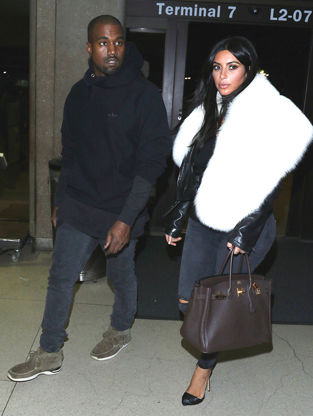 Kanye West and Kim Kardashian are seen at LAX on January 07, 2015 in Los Angeles, California.