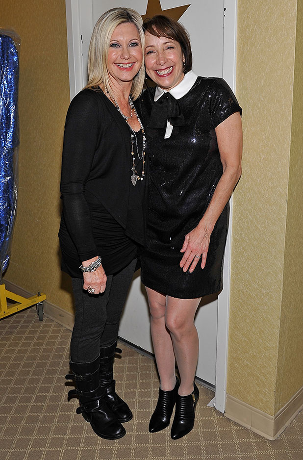 Olivia Newton-John (L) and actress Didi Conn reunite on stage to perform 'Summer Nights' at Flamingo Las Vegas on January 3, 2015 in Las Vegas, Nevada.