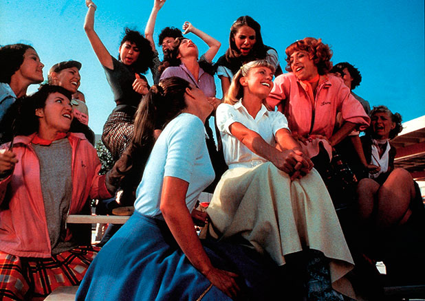 Olivia Newton-John, Didi Conn and the rest of the girls sing in a scene from the film 'Grease', 1978.