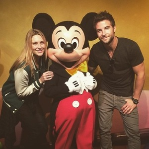 Stephanie Pratt and Josh Shepherd meet Mickey Mouse in Disneyland, California