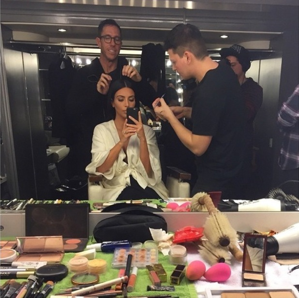 Kim Kardashian West takes a mirror photo at her dressing table while having her hair and make-up done - 13 January 2015