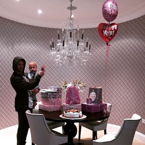 Frankie Bridge is treated to presents and cake on her birthday by husband Wayne and son Parker. 14 January