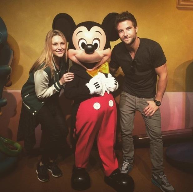 Stephanie Pratt and Josh Shepherd meet Mickey Mouse in Disneyland, California
