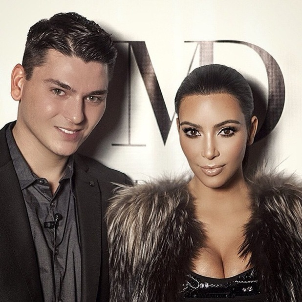 Kim Kardashian West poses for a photo after having her make-up done by Mario Dedivanovic at his make-up masterclass in New York - 11 January 2015