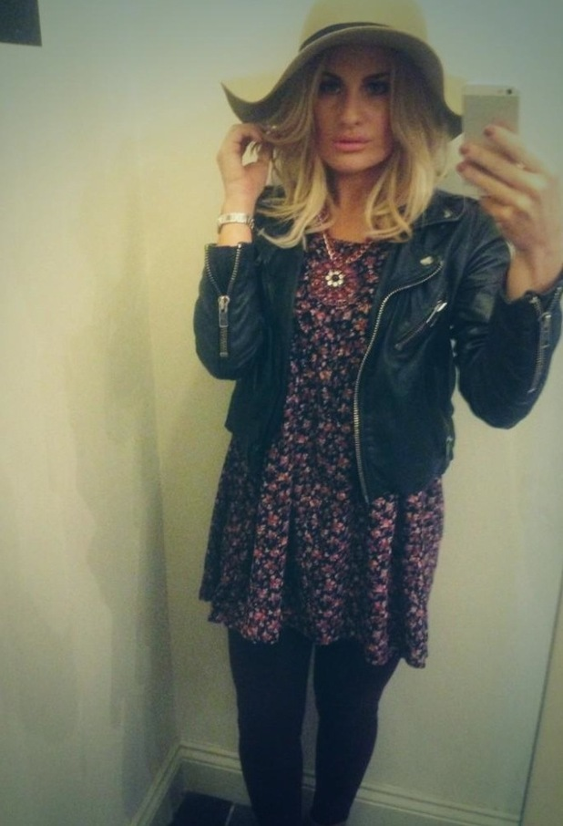 Danielle Armstrong's Twitter photo, trying on the clothes at her shop