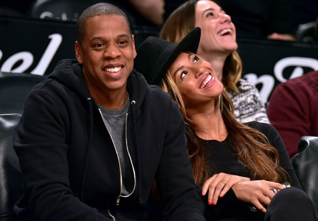 Jay-Z and Beyonce Knowles attend the Houston Rockets vs Brooklyn Nets game at Barclays Center on January 12, 2015 in New York City. (Photo by James Devaney/GC Images)
