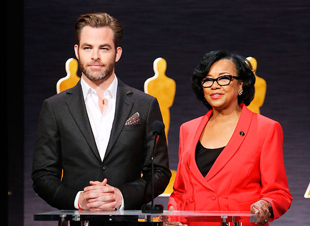 Chris Pine (L) and Academy president Cheryl Boone Isaacs speak onstage during the 87th Oscars nominations announcement held at AMPAS Samuel Goldwyn Theater on January 15, 2015 in Beverly Hills, California.