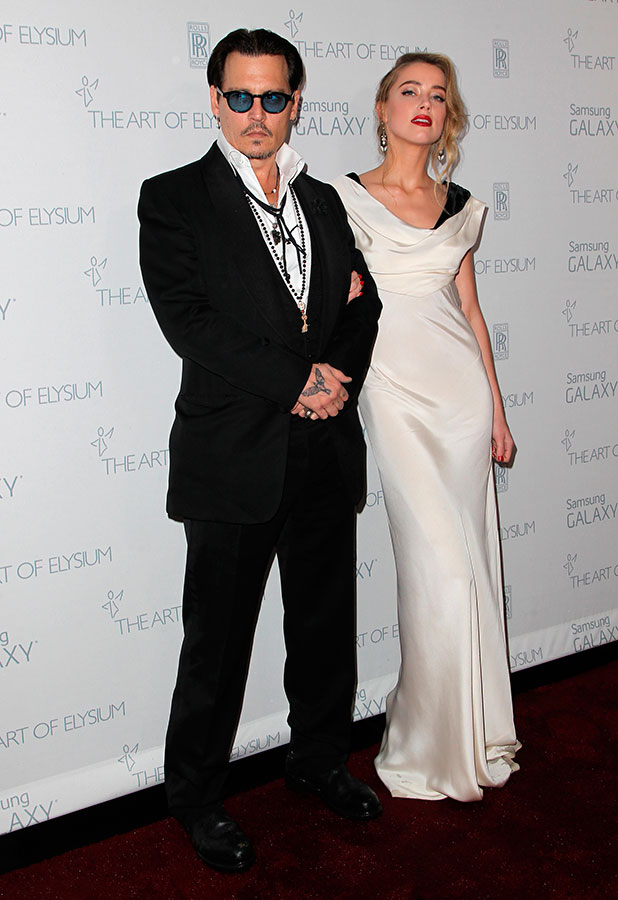 Johnny Depp (L) and honoree Amber Heard attend the 8th Annual HEAVEN Gala presented by Art of Elysium and Samsung Galaxy at Hangar 8 on January 10, 2015 in Los Angeles, California.