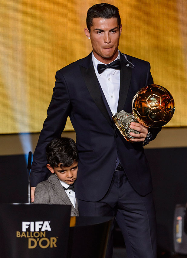 Cristiano Ronaldo (R) stands with his son Cristiano Jr after receiving the 2014 FIFA Ballon d'Or award for player of the year during the FIFA Ballon d'Or award ceremony at the Kongresshaus in Zurich on January 12, 2015.