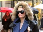 Paris Hilton oozes daytime glamour while beating the rain in Milan