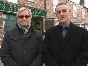Coronation Street filming - William Roache and executive producer Kieran Roberts outside the Rovers Return. Manchester, United Kingdom. 20/1/2015.