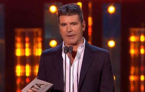 Simon Cowell accepts TV Judge award on behalf of David Walliams at the National Television Awards - 21 January 2015.