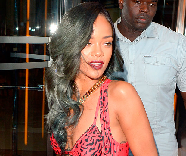 Rihanna shopping for two hours at the Roberto Cavalli store, wearing a red Adidas leopard print jumpsuit, 7 July 2013
