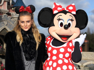 Little Mix's Perrie Edwards strikes a pose with Minnie at Disneyland Paris