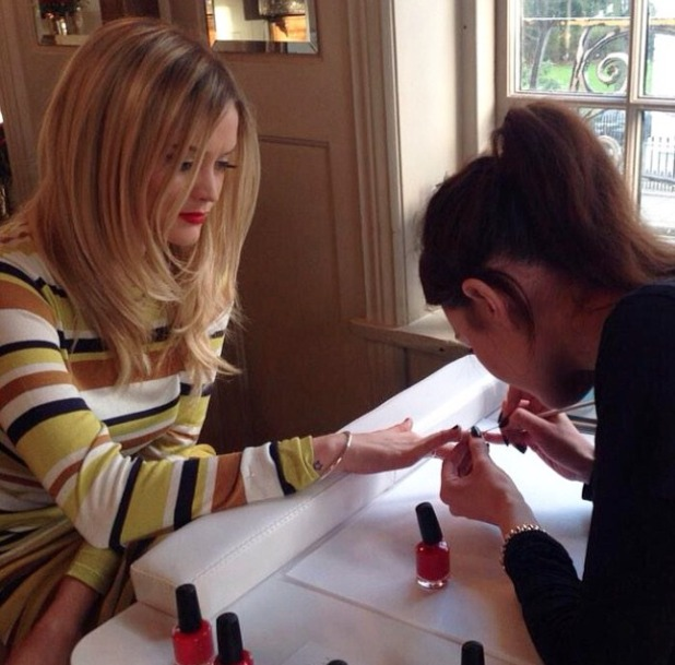 Laura Whitmore has a love heart manicure by Sophia Stylianou, for the launch of new Pandora heart charm for The British Heart Foundation. 'Wear it. Beat it.' afternoon tea at Bumpkin, South Kensington, London, 28 January 2015