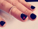 The sexy TV presenter hosts British Heart Foundation event with very apt nails!