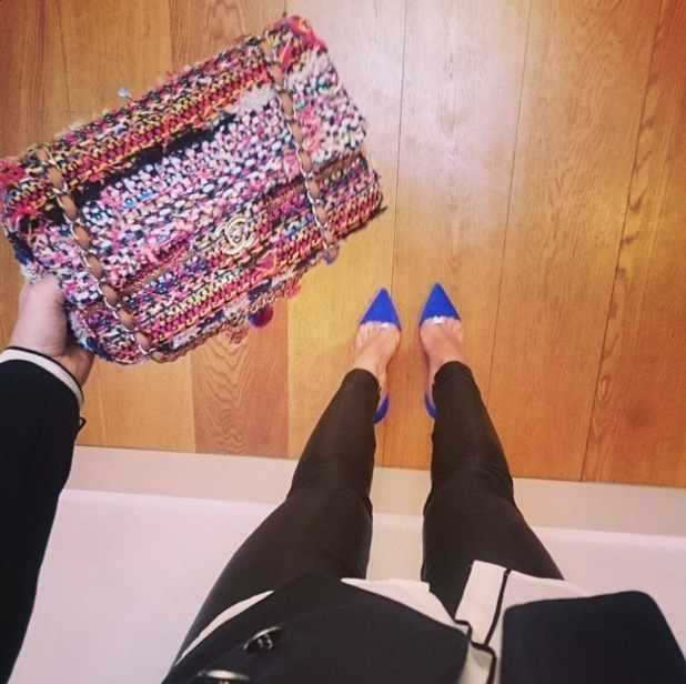 Rosie Fortescue shows off her Chanel handbag before heading to the Pretty Ballerinas spring/summer '15 launch party in London - 4 February 2015