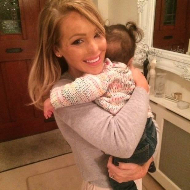 Katie Piper cuddles Belle after a long day at work - 4 Feb 2015