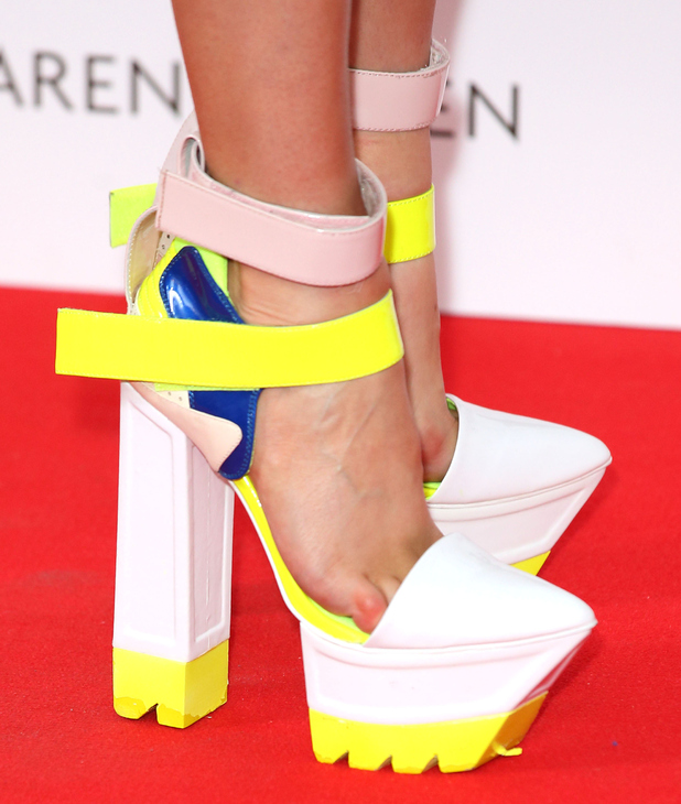 Laura Whitmore makes a statement in GIANT platform heels ...