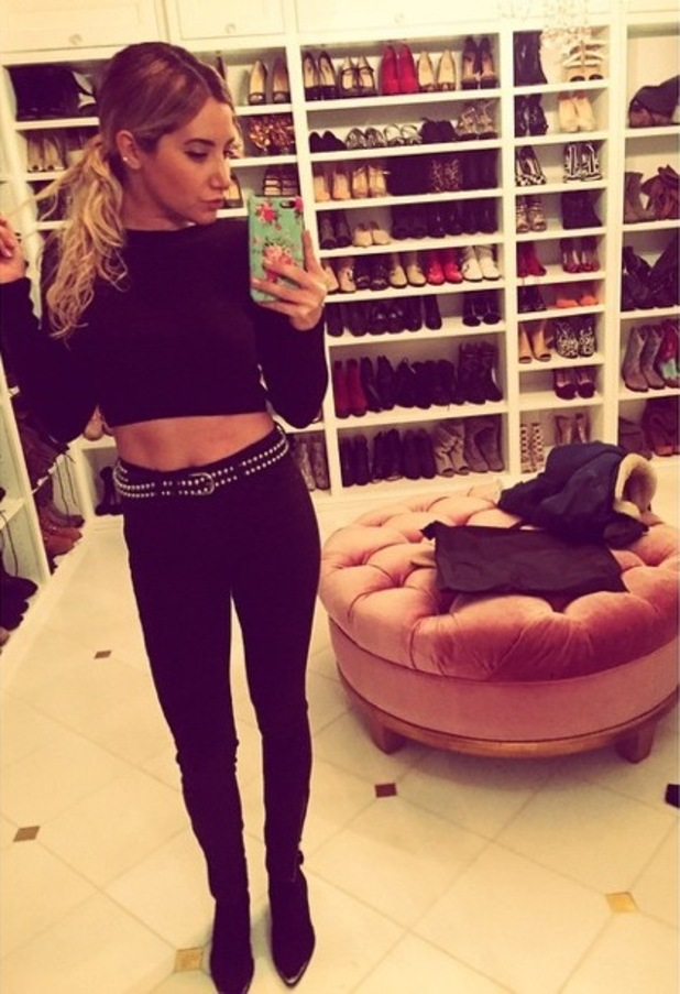 Ashley Tisdale takes an outfit photo while showing off her huge shoe wardrobe - 4 February 2015