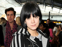 Lily Allen wears a Louis Vuitton cape while attending the Topshop Unique show at London Fashion Week - 18 September 2010