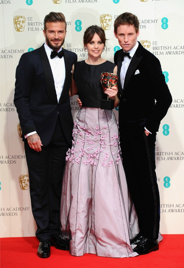 David Beckham, Felicity Jones and Eddie Redmayne pose in the winners room at the EE British Academy Film Awards at The Royal Opera House on February 8, 2015 in London, England. (Photo by Stuart C. Wilson/Getty Images)