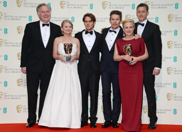 Jonathan Sehring, Cathleen Sutherland, Ellar Coltrane, Ethan Hawke, Patricia Arquette and John Sloss celebrate Best Film 'Boyhood' in the winners room at the EE British Academy Film Awards at The Royal Opera House on February 8, 2015 in London, England.