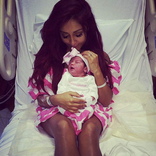 Snooki shows picture of baby Giovanna and herself one hour after birth, 2 February 2015