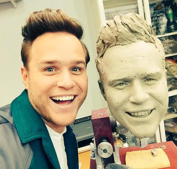 Olly Murs poses with his new as-yet-unfinished waxwork - 12 February 2015.